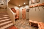 Large open foyer with plenty of hooks for storage and ski gear.