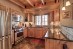Large, gourmet kitchen w/granite counters, stainless appliances, wine frig.