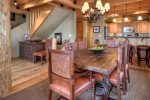 Dining table seats 6-8 with adjacent breakfast bar and kitchen/heated floors
