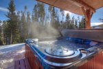 Enjoy a beverage of your choice while you soak in your own private hot tub