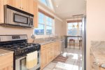 Amazing views from kitchen with granite counters and bar seating for 2.
