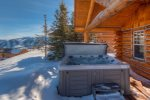 Bedroom 1 with queen bed, flat screen TV and views of Lone Peak
