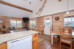 Bedroom 2 with 2 twin beds, flat screen TV, and spectacular views of Lone Peak