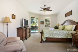 Master Bedroom with access to pool area and flat screen tv