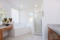The en-suite master bathroom with his n hers sink, walk-in shower and roman tub is situated on the first floor.