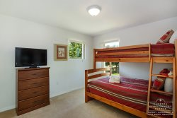 The fourth bedroom has a bunk bed and for the kids enjoyment a flat screen TV.