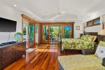 Here is your master suite, king bed, wood floors, double sliders and your own lanai