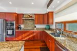 Gorgeous cabnetry, wine cooler, mahogany flooring