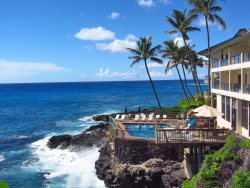 Dramatic Oceanfront One Bedroom with central AC, romantic setting with amazing over ocean lanai