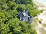 This dream home is nestled in the wooded dunes overlooking Lake Michigan