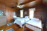 Bedroom 1 upstairs with 3 twin beds and a twin trundle bed picture 2 of 2