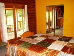 Duck Inn Log House - Master Bedroom - French Doors To Covered Porch
