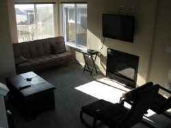 Oceana - Mid Level - Living Room - Gas Fireplace - Large Flat Screen TV