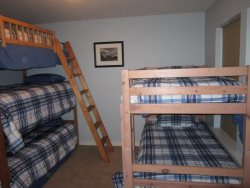 A Cut Above - Second Floor - Bedroom 4 with 2 bunk bed sets 5 twins