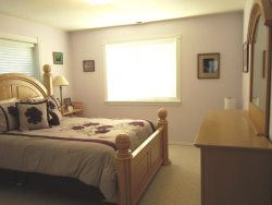 Ocean Breeze - Upper Level Bedroom 2, with Queen bed, photo 1