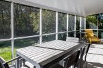 Screened-in Porch Provides Space for Outdoor Dining