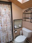 The second floor offers a full bathroom with shower/tub combo
