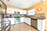 Kitchen with Granite Countertops & Updated Stainless-Steel Appliances