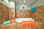 Large Master en Suite with Large Soaking Tub, lower level
