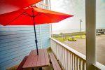 Picnic Table with Umbrella on Balcony