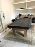 Pool table in the garage for countless hours of endless fun