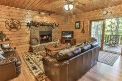 Game Room Den with Gas Fireplace and Walkout to Outdoors