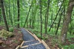 Custom hiking trail to creek and fire pit.