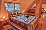 Queen bed in loft with bear bunks.