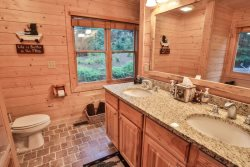 Large ensuite bathroom off main floor master with dual sinks, walk-in shower and soaking tub.