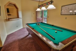 Pool table in basement game room.