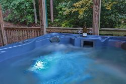 Soak in the hot tub overlooking the mountains.