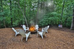 Private woodland setting with firepit.