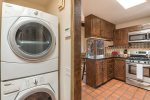 Stackable washer & dryer & kitchen area