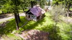Aerial of the front yard, cabin, and studio apartment out back.