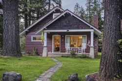 Large yard, covered front porch, adorable little cabin at the resort side of Wallowa Lake.
