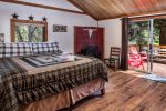 Master bedroom has an adjoining bath and a sliding glass door onto the deck that overlooks the Wallowa River.