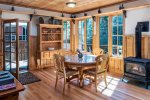Eating area with windows out to the Wallowa River.