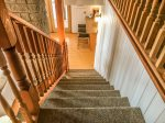 Staircase to the lower level where the utility room, additional private king bedroom and full bath.