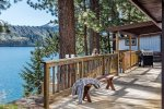 Long deck wraps around the front part of the house with a view of Wallowa Lake.
