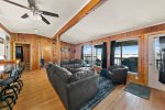 Large living room with picture windows that look out onto Wallowa Lake.