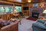 Knotty pine interior cabin with wood burning fireplace with nice private location at the resort side of Wallowa Lake.