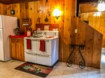 Vintage stove but fully functional adds to the ambiance of this fantastic cabin