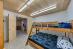 Lower bedroom with a king is attached to the kids bunk room and half bath.