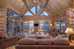 Custom built log home with large deck overlooking your private boat dock!