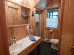 Lower bathroom offers a shower stall.