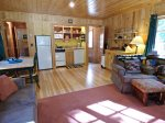 Sit and enjoy the covered deck with bbq and comfortable seating at the Ram`s Head cottage.
