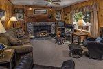Living room offers a queen hide a bed as well as a wood burning stove.