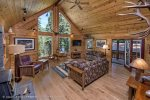 Stunning views of the trees thru the gorgeous tall windows and vaulted ceilings.