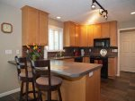 Nice full kitchens with bar seating and deluxe appliances