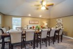 Large dining area with huge table to comfortably seat 14